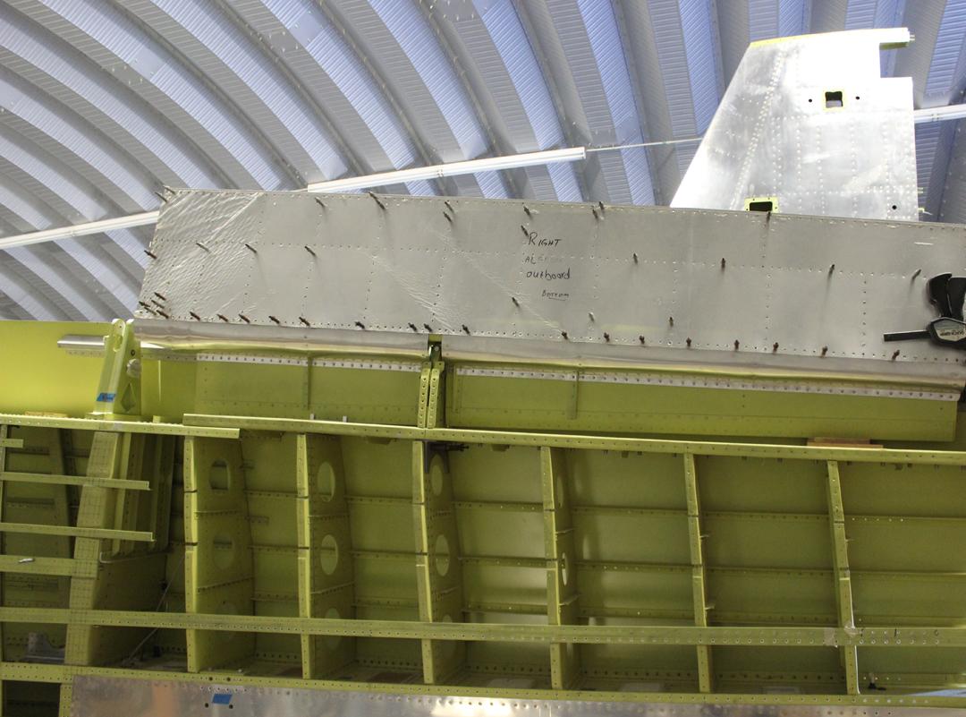 Fitting the ailerons. (photo via Tom Reilly)