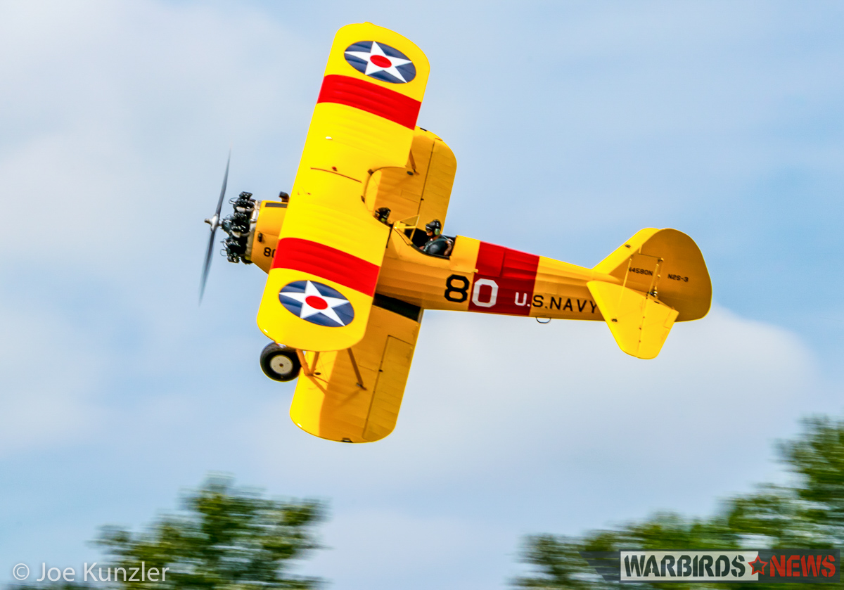 Alex Bock's N2S-3 Stearman doing a 'Banana Pass' to show off her top side to the crowd. (photo by Joe Kunzler)