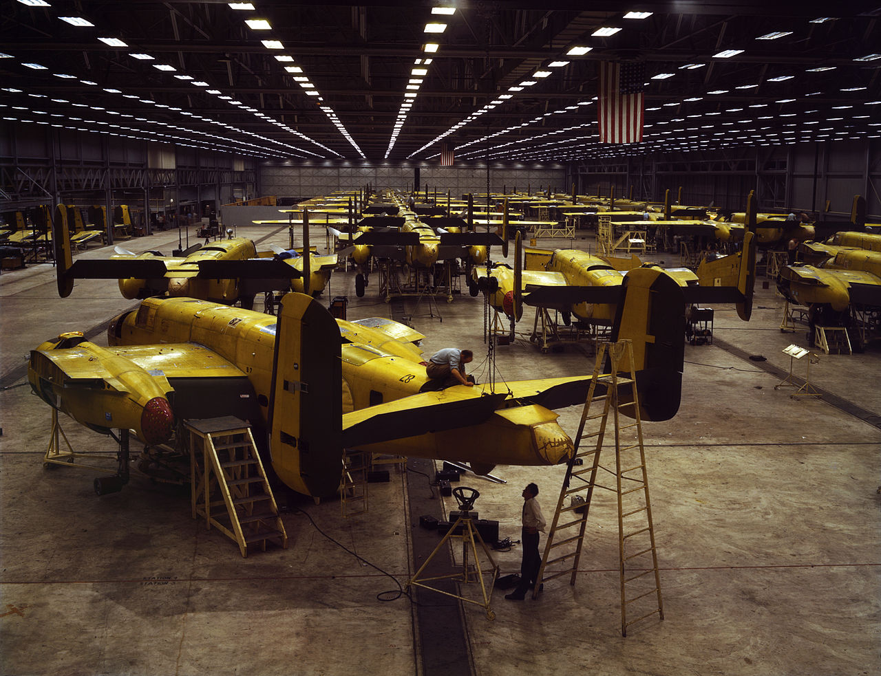 North American B-25 Mitchell production in Kansas City in 1942 Assembling the North American B-25 Mitchell at Kansas City, Kansas (USA). Reproduction digitized from original 4x5 color transparency.