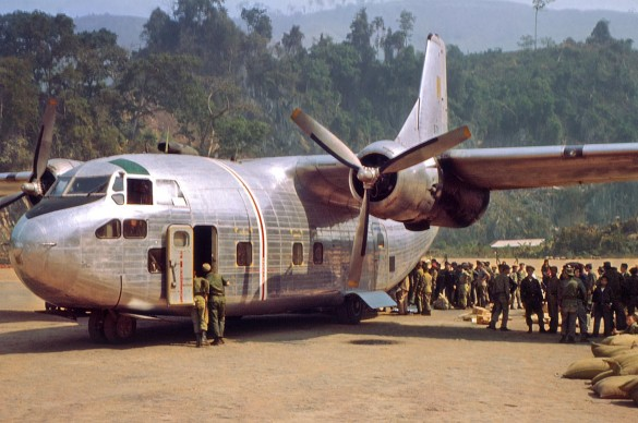 An-Air-America-C-123-delivering-supplies-and-picking-up-Laotian-troops-at-Long-Tieng.-RLW-585x388