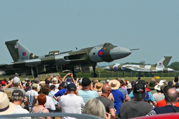 Vulcan XH558 landing after her aerial display earlier this year at the Waddington Air Show with static display XM607 in background. (Image Credit: Alan Wilson CC 2.0)