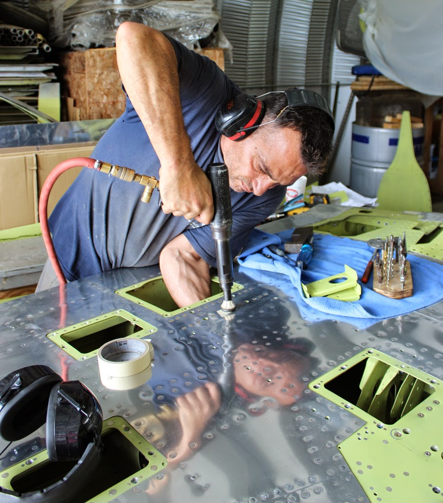 Ayman working on one of the two vertical stabilizers. (photo via Tom Reilly)