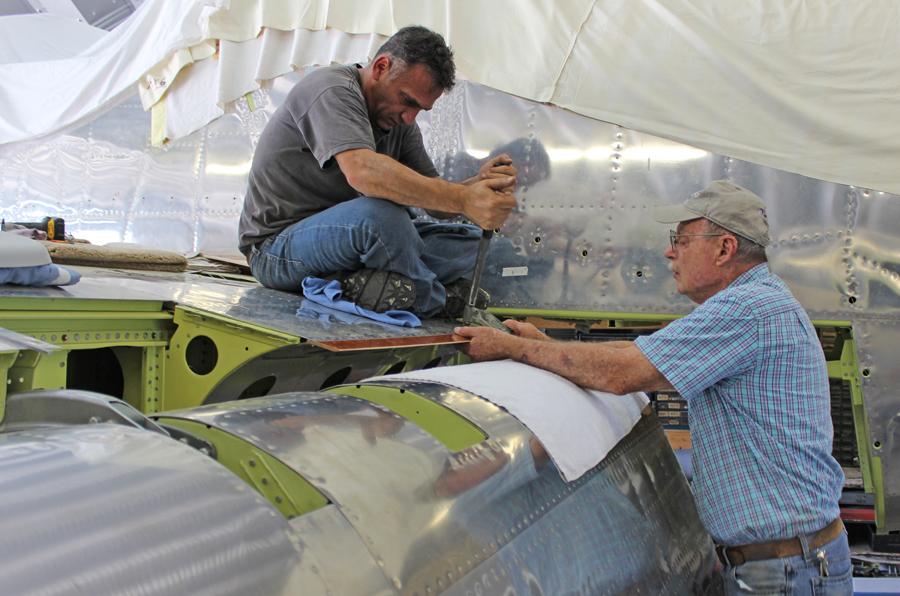 Tom Reilly (r) with Ayman installing the phenolic rub-strip for the flap. (photo via Tom Reilly)