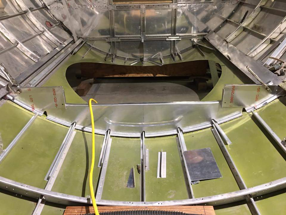 This hole in Desert Rat's fuselage floor is where the ball turret will eventually go. (photo via Vintage Aviation Museum)