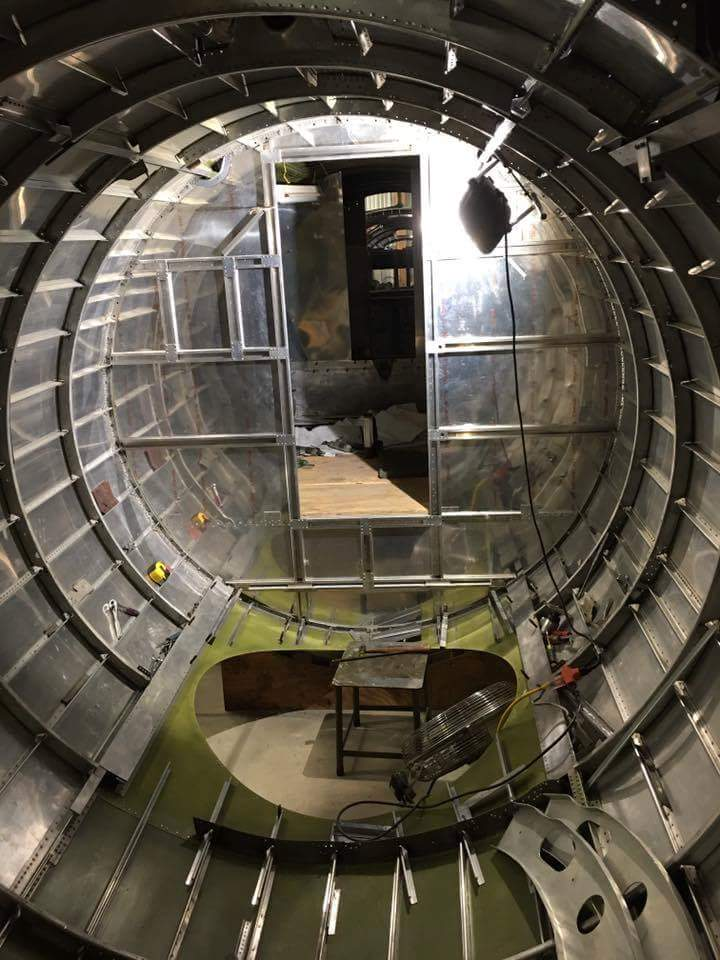 Desert Rat's fuselage interior. The hole in the floor will one day hold the ball turret, and the radio room bulkhead is just beyond.  (photo via Vintage Aviation Museum)