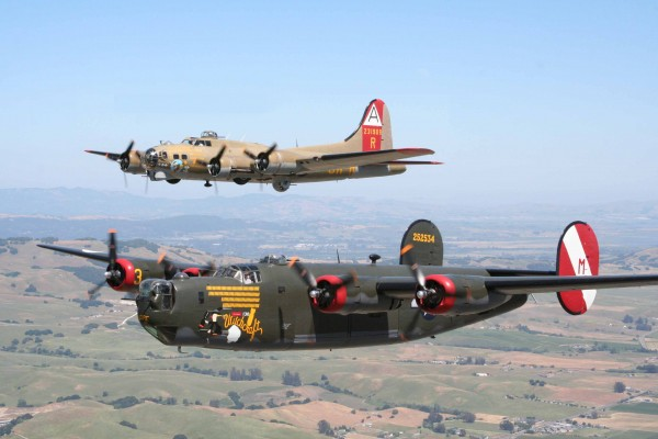 """The Foundation's 1944 vintage Consolidated B-24J Liberator is painted as """"Witchcraft"""", an 8th AF bomber that flew a record 130 missions over Europe as part of the 467 th BG. The Boeing B-17G Flying Fortress flies as """"Nine-O-Nine"""", an 8 th Air Force, 91 st BG heavy bomber. ( Image by Collings Foundation)"""