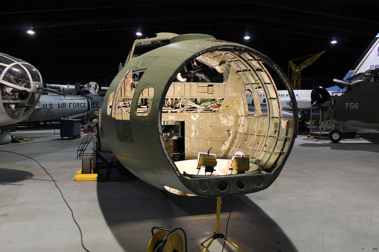 View inside the B-17's nose compartment with the windows removed. The light stand is in the hole where the chin turret was located. ( Photo via Museum of Aviation Warner Robins)