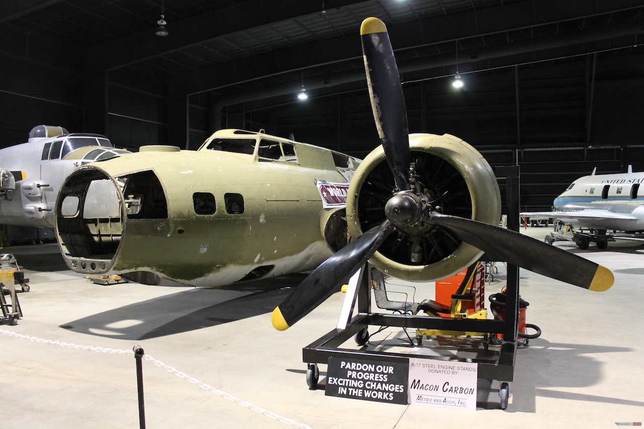 One of the B-17's engines mounted on a stand for display and restoration. The ball turret has been mounted on a support fixture and restoration volunteers have been removing components for inspection, cleaning, and repair. ( Photo via Museum of Aviation Warner Robins)