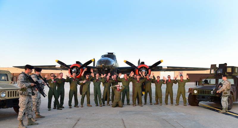 "Members of the 13th Bomb Squadron (BS) pose for a reenactment photo depicting the ""acquiring"" of a North American B-25 Mitchell at Whiteman Air Force Base, Mo., June 11, 2017. The 13th BS celebrated 100 years of service on June 14, 2017. 75 years ago, the 13th ""acquired"" 24 B-25s from the Dutch Air Force during World War II. (U.S. Air Force photo by Tech. Sgt. Tyler Alexander)"