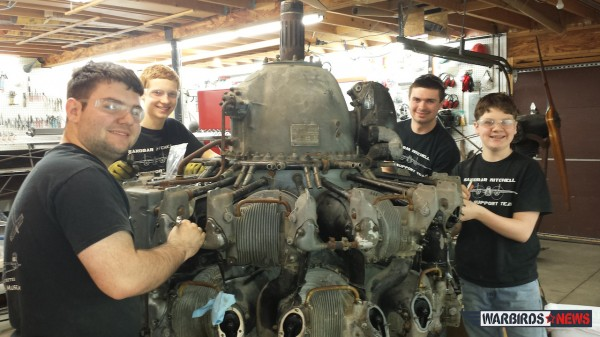 The youth team working on the clapped out R-2800 engine, which they will restore to static display for a Florida museum. (photo via Sandbar Mitchell)