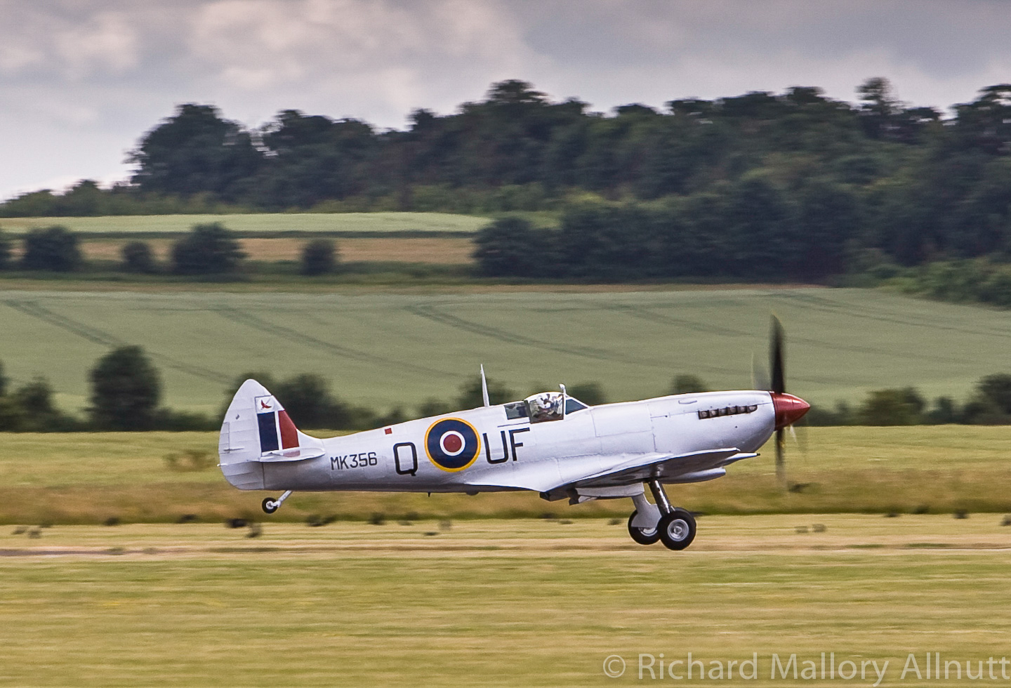 The Battle of Britain Memorial Flight's Spitfire Mk.IXe MK356 taking off at Duxford. (photo by Richard Mallory Allnutt)