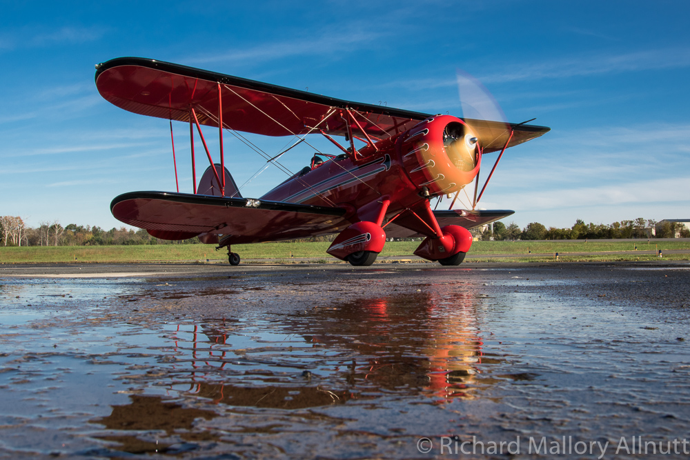 John Corradi's WACO YMF about to depart with a passenger aboard. (photo by Richard Mallory Allnutt)
