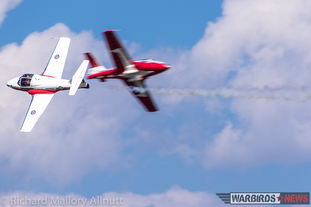 One of the Snowbirds' classic synchro-pair head-to-head passes. (photo by Richard Mallory Allnutt)