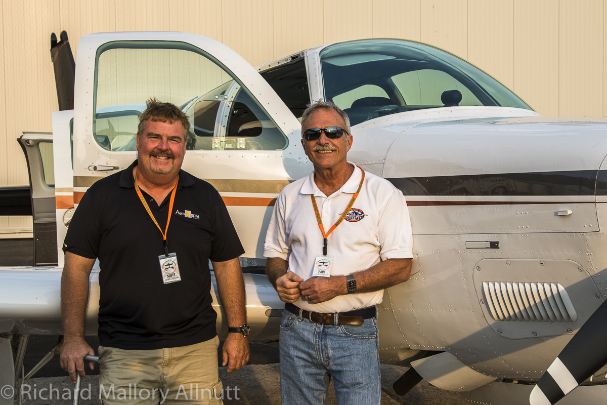 Scott Slocum (l) and Paul Bowen (r) standing in front of Slocum's gleaming Beach Bonanza which will be the photo-ship for many of the air-to-air sessions. (photo by Richard Mallory Allnutt)