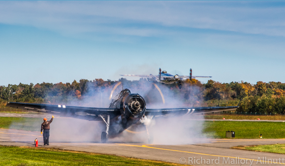 Panchito lifts into the autumn skies as the locally based CAF National Capitol Squadron's TBM starts up in a cloud of smoke. (photo by Richard Mallory Allnutt)