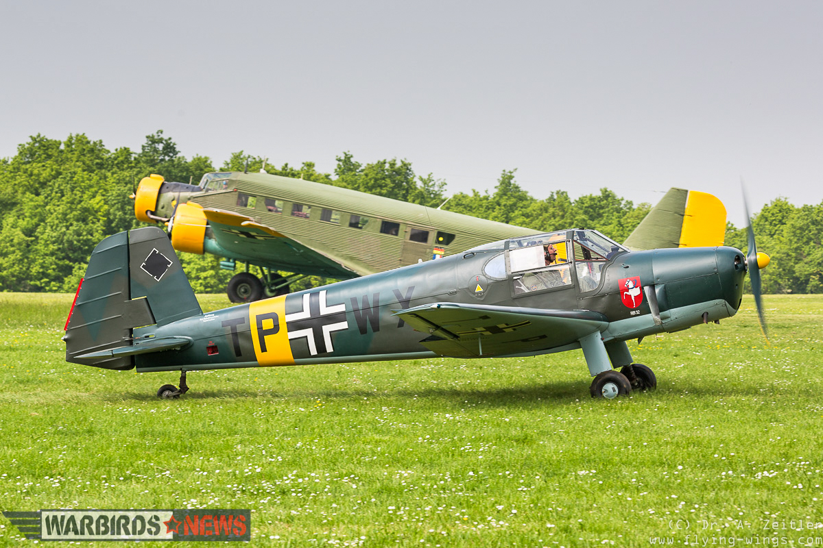 A Bücker Bü 181 Bestmann taxis in front of a Junkers Ju-52, one of two such transports flying at the show. (photo by Andreas Zeitler)
