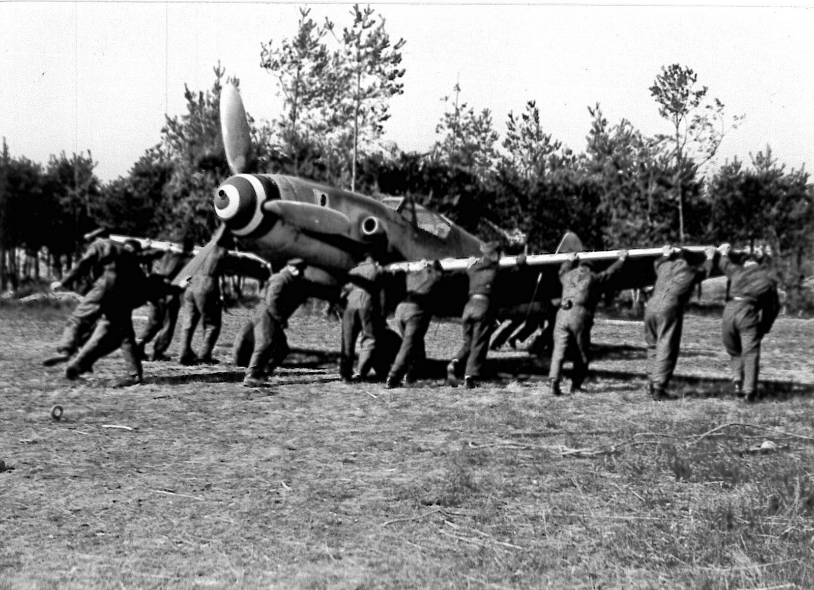 Visconti's Bf-109G being pushed in the sheltered area of Lonate Pozzolo airfield. ( Luigino Caliaro Archive)