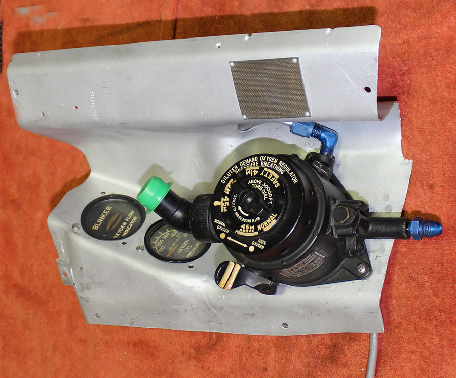 The pilot's oxygen diluter with its associated gauges mounted to the removable cockpit panel. (photo via Tom Reilly)