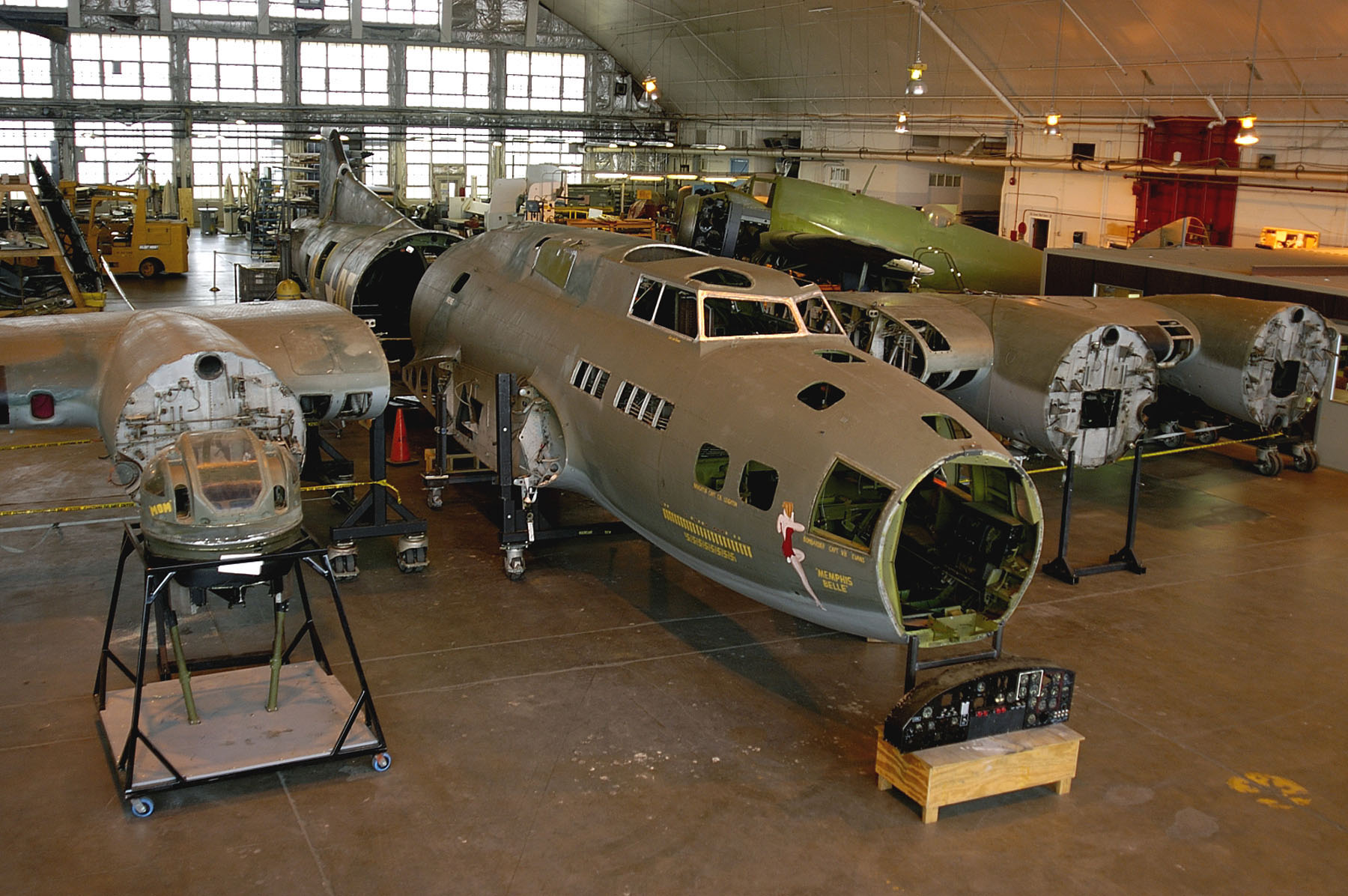 "DAYTON, Ohio -- The B-17F ""Memphis Belle"" is readied for restoration at the National Museum of the United States Air Force. (U.S. Air Force photo)"