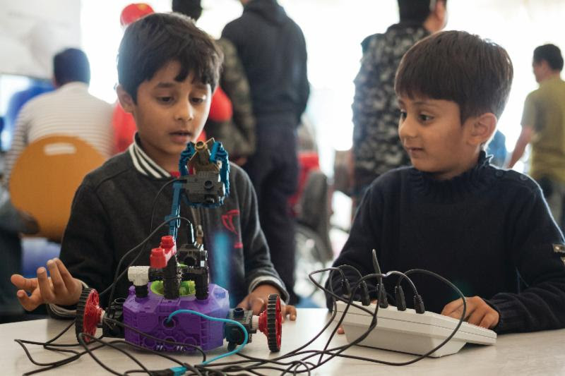 Boys build their own robot during a workshop at The Museum of Flight. Photo Ted Huetter/The Museum of Flight.