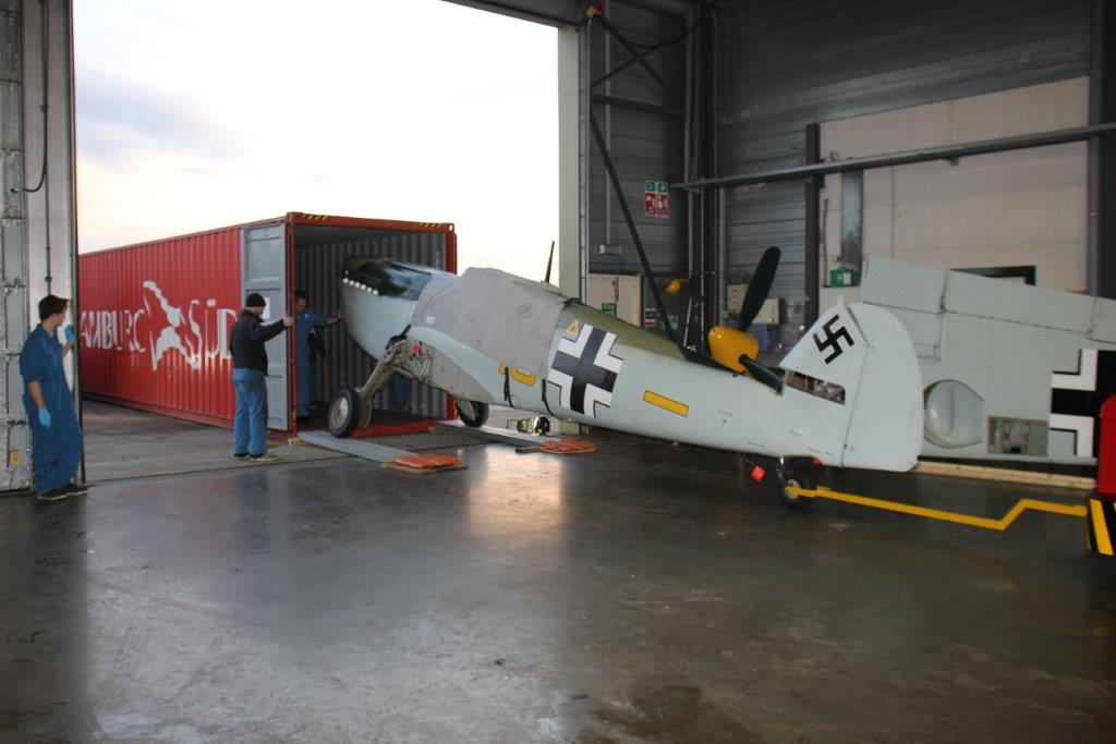 John Romain's Hispano Buchon being loaded into its Hamburg Süd shipping container for the long voyage to New Zealand where man and machine will participate in this Easter's Warbirds Over Wanaka International Air Show. (photo via WOWIAS)
