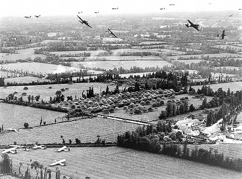 C-47 releasing gliders over Normandy. (Photo via Pete Mecca)