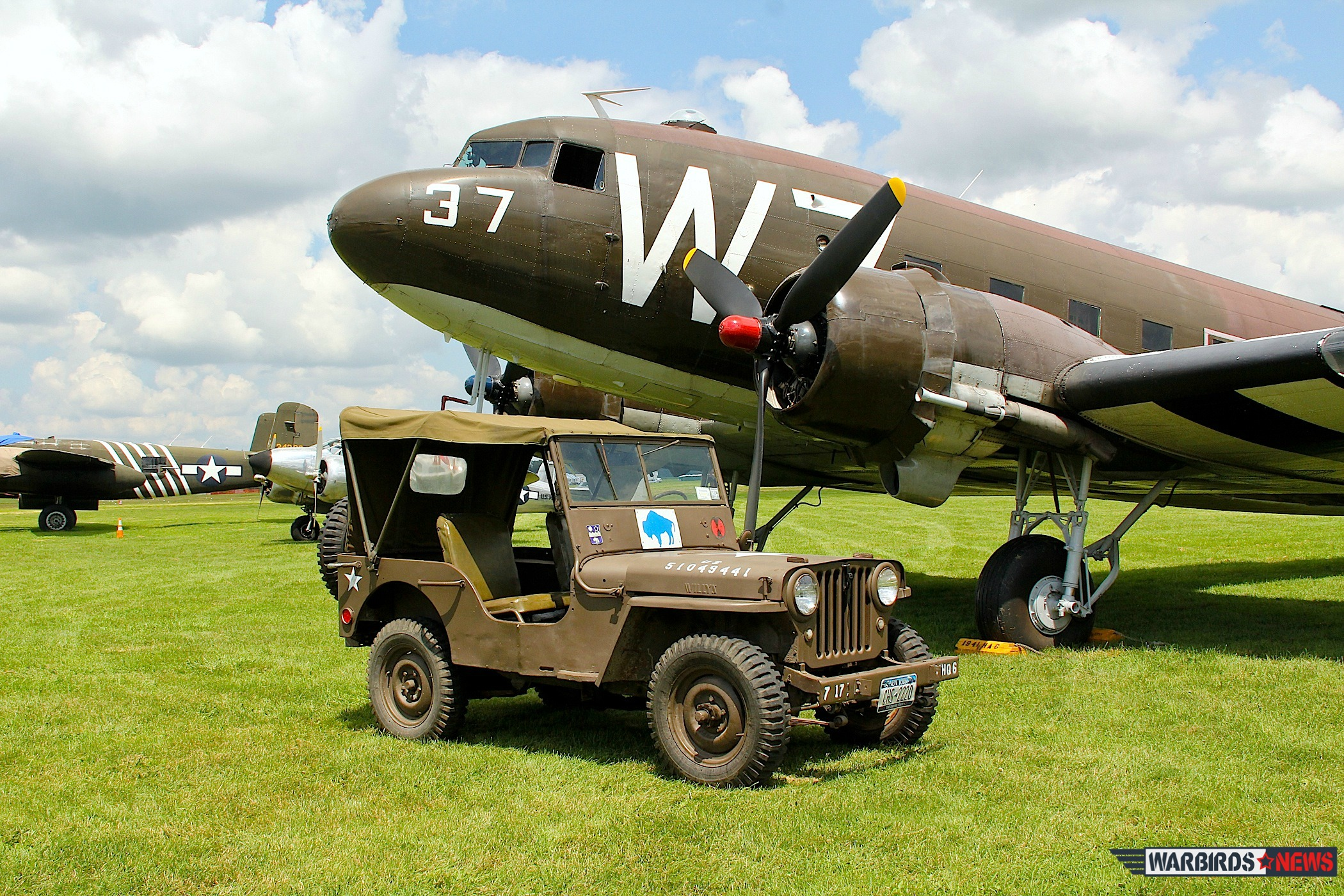 "Seen last year, the National Warplane Museum's C-47 ""Whiskey 7"" made the journey to France for the 70th anniversary of D-Day. ( photo via NWM)"