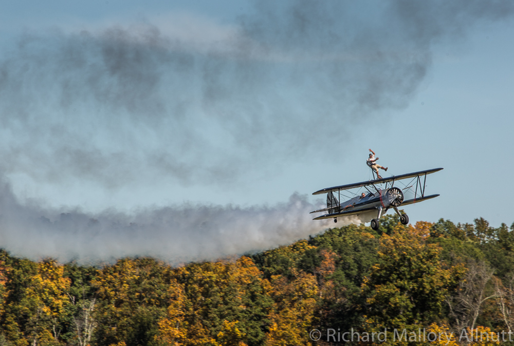 Pulling the Stearman down low along the runway with the fall colors sparkling on the trees behind. (photo by Richard Mallory Allnutt)