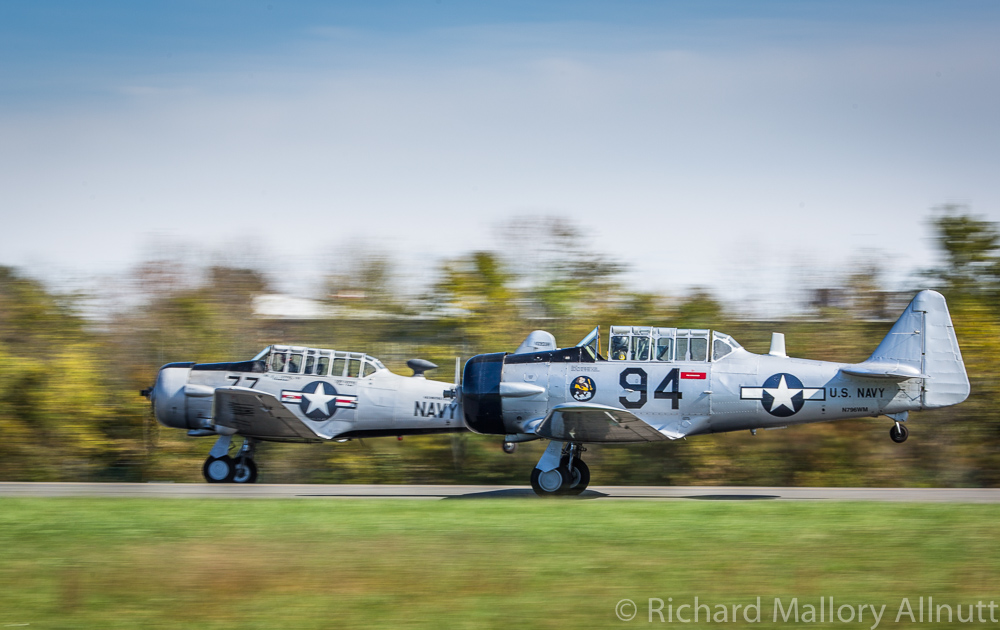 A pair of Texans taking off in formation. (photo by Richard Mallory Allnutt)