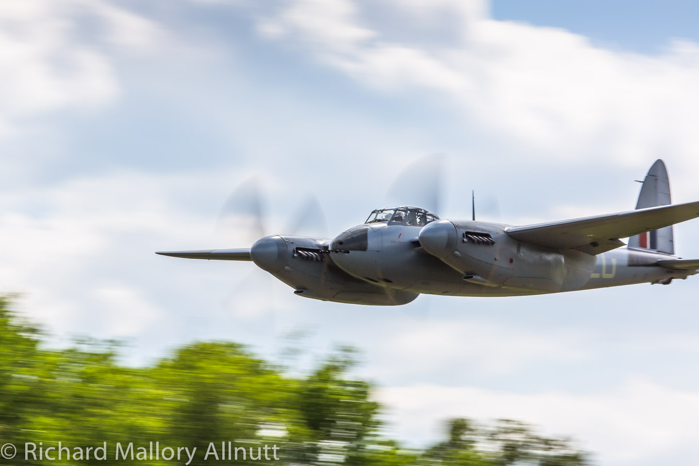 The deHavilland Mosquito during a particularly spirited pass of the airfield during the Friday practice flight in 2014. (photo by Richard Mallory Allnutt)