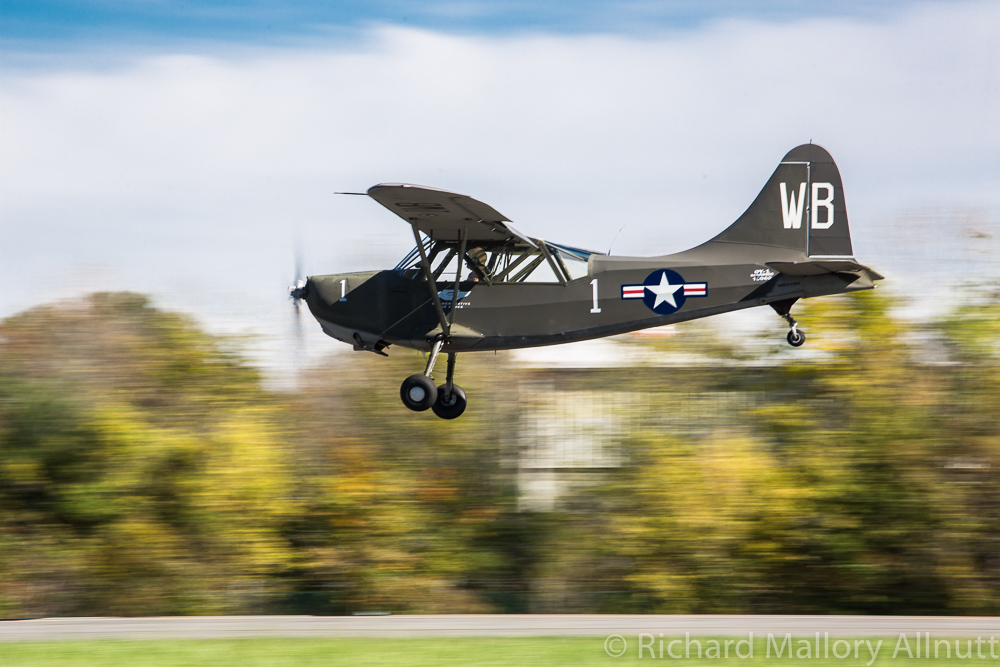 The CAF Old Dominion Squadron's Stinson OY-1 Sentinel was one of several L-birds performing at the show, including the locally based National Capitol Squadron's L-5 Sentinel. (photo by Richard Mallory Allnutt)