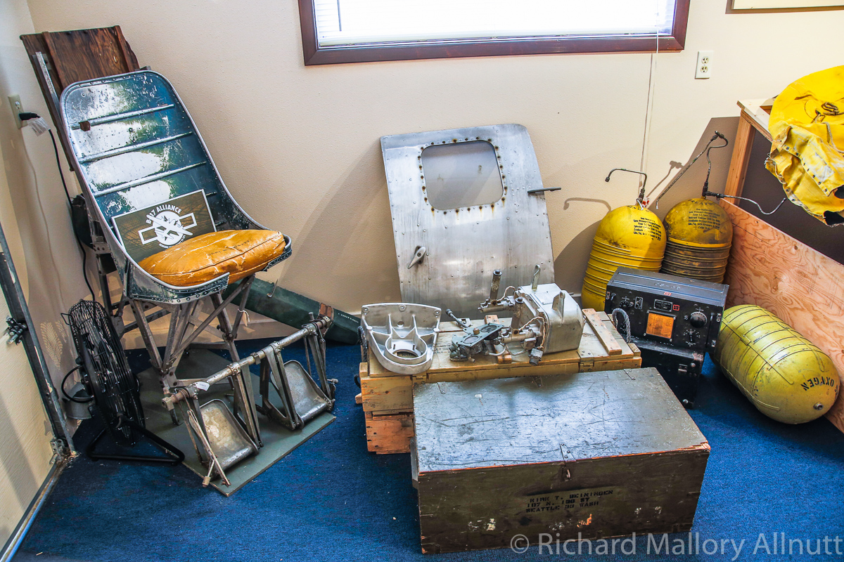Pilot's seat, rear entry door and various other items from Lacey Lady in the museum. (photo by Richard Mallory Allnutt)