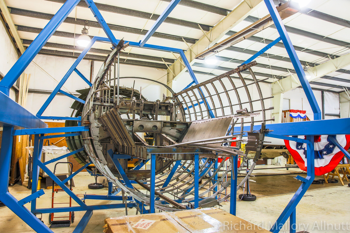The mostly disassembled cockpit section in its jig. (photo by Richard Mallory Allnutt)