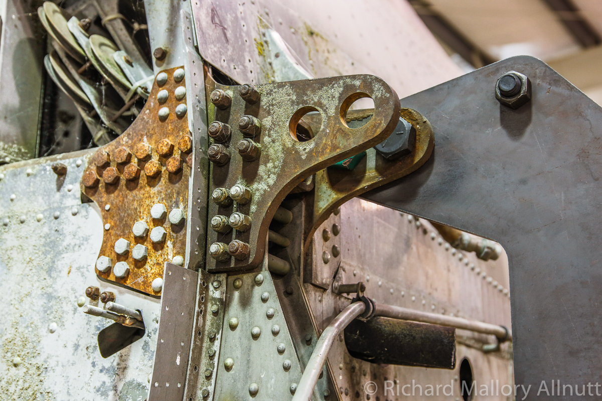 A closeup view of the port forward upper wing attachment hinge and the jig attachment point. (photo by Richard Mallory Allnutt)