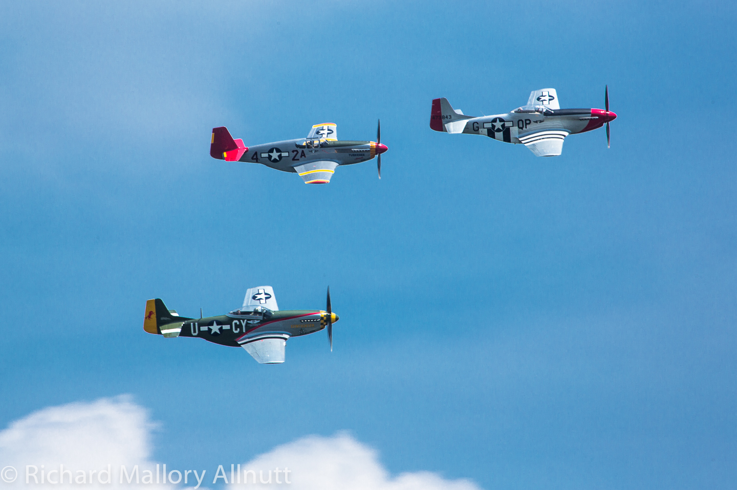 The Red Tail Squadron's P-51C (center) in formation with the CAF's two other Mustangs as they are about to make the turn over Washington, DC for the Arsenal of Democracy Flyover. (photo by Richard Mallory Allnutt)