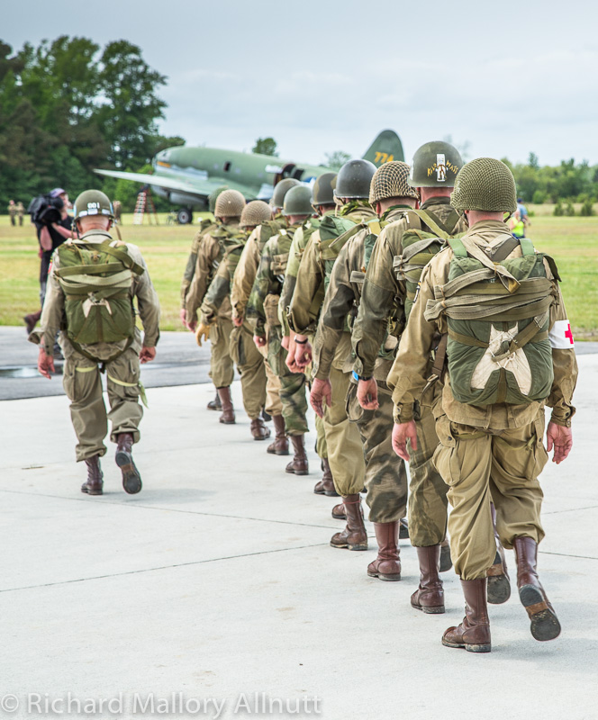 Members of the WWII Airborne Demonstration Team await boarding their Curtiss C-46F Commando troopship in Pungo, Virginia during the Warbirds Over the Beach Air Show in 2013.  (photo by Richard Mallory Allnutt)