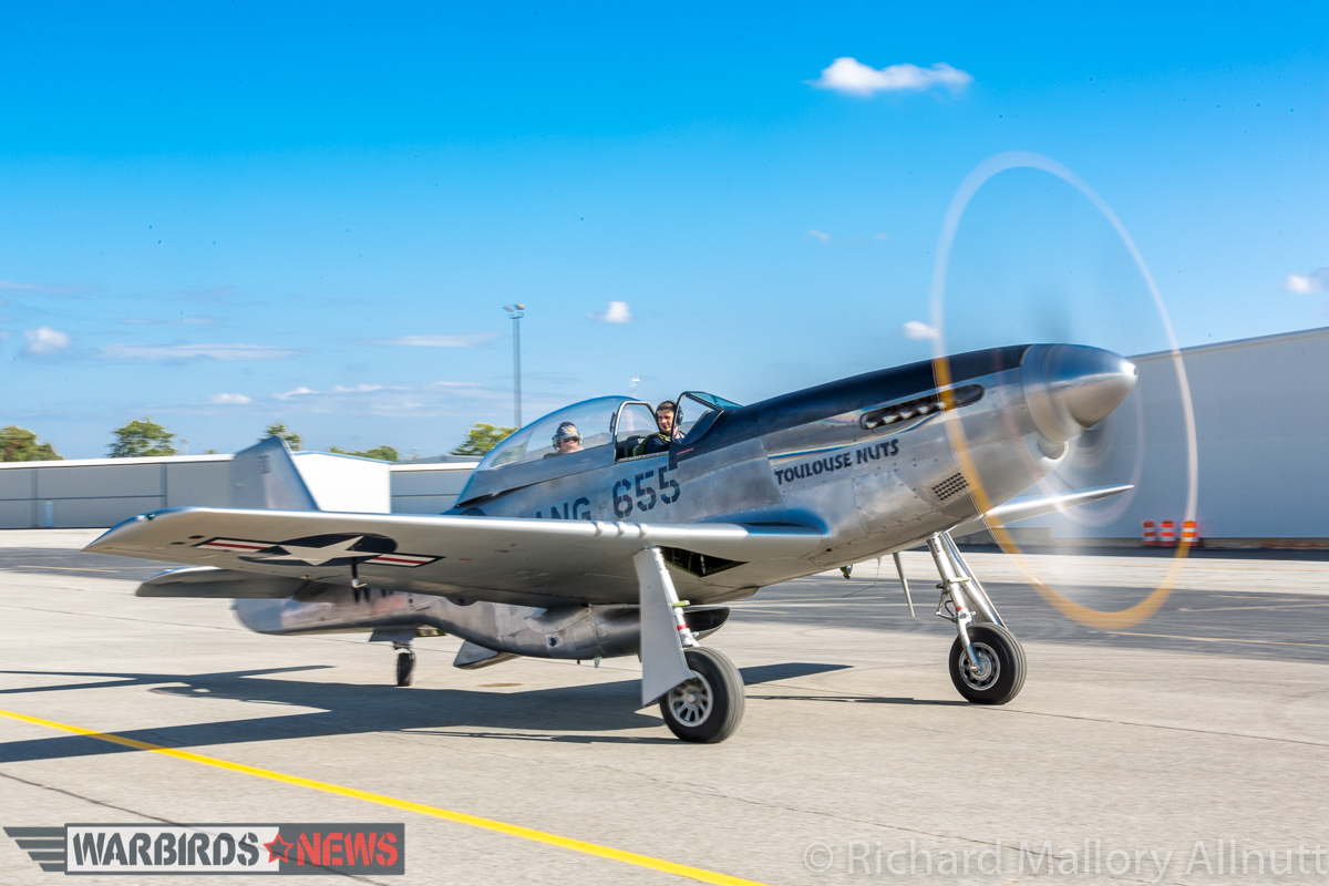 "The Collings Foundation's TF-51D ""Toulouse Nuts"" taxis out at Roanoke Regional Airport for one of several passenger rides that day. (photo by Richard Mallory Allnutt)"