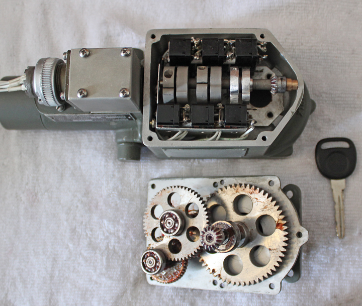 Another image of a Carburetor Air Temperature Control Motor with it's protective lid removed beside a reduction gear assembly. (Photo via Tom Reilly)(Photo via Tom Reilly)