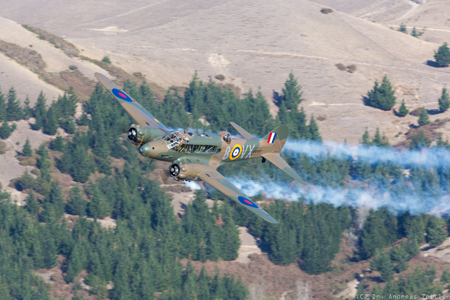The Anson streaming fake smoke from its engines during its display. (photo by Anders Zeitler)