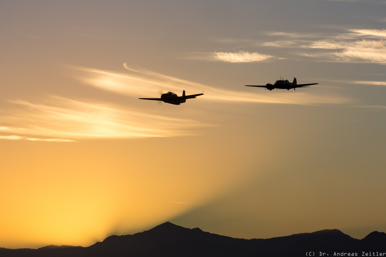 The Avenger and Anson silhouetted by the setting sun in a glorious New Zealand skyline. (photo by Anders Zeitler)