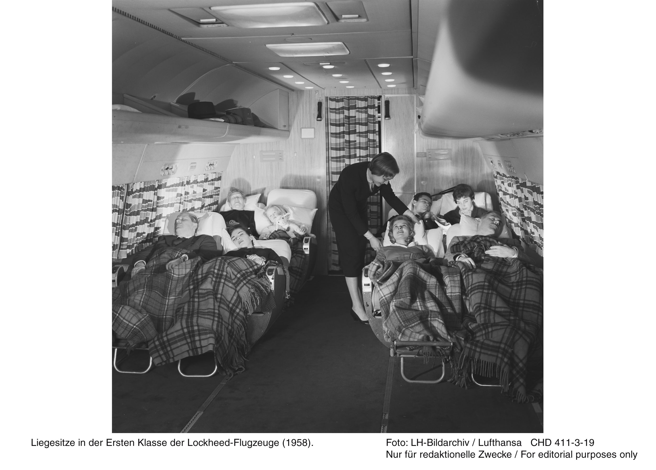 Another view of the 1st class cabin in a Lufthansa Lockheed L-1649A Super Star showing the reclining seats in action. (photo via Wolfgang Borgmann)