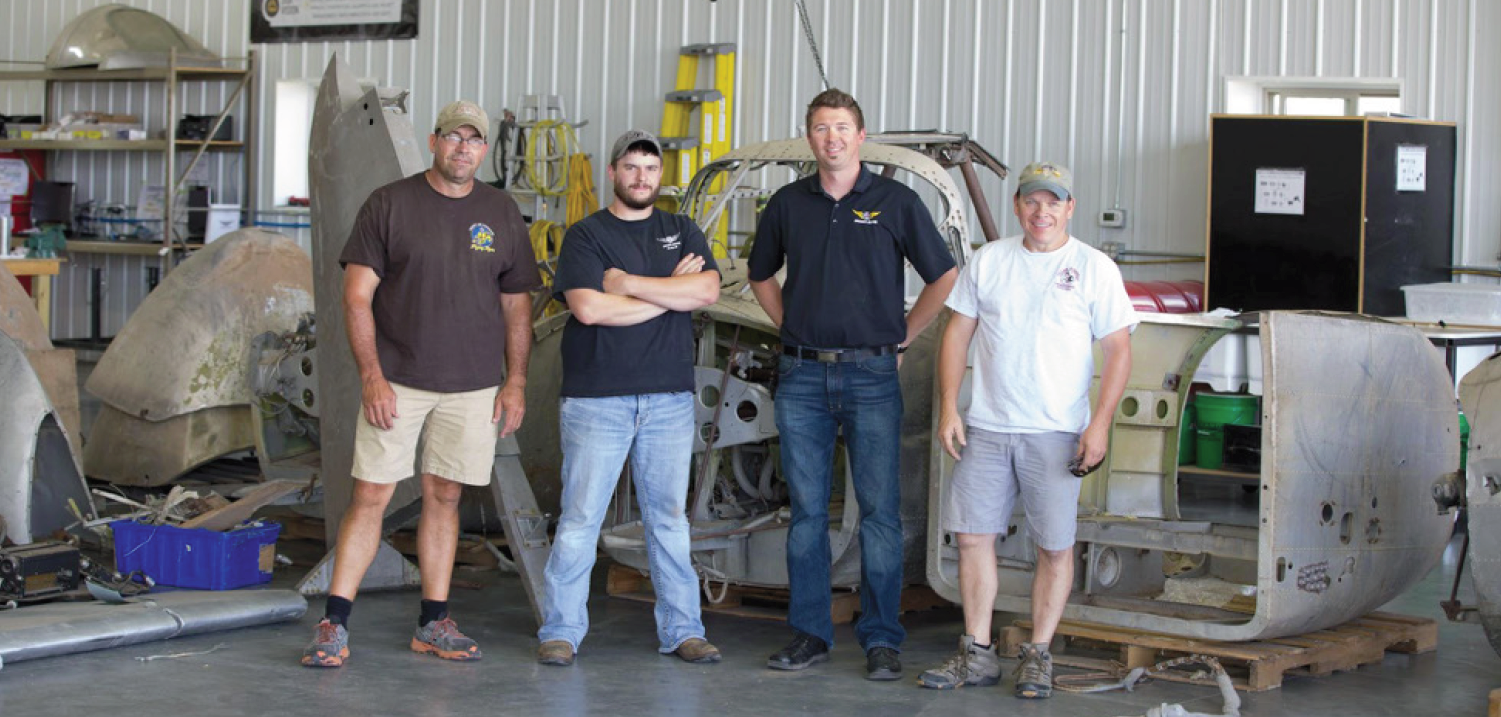 Left to right, Brooks Hurst, Tye Halvas (AirCorps Maintenance Manager), Erik Hokuf (AirCorps' General Manager), and United States Congressional Representative Sam Graves of the Missouri Sixth District.