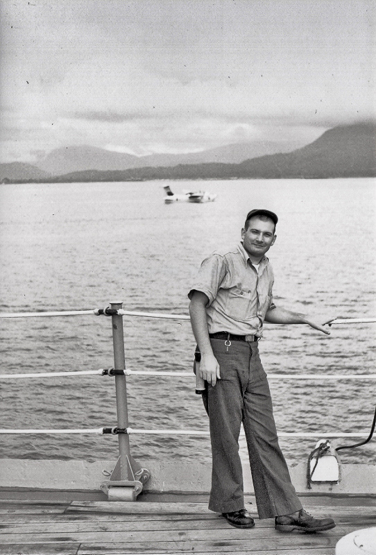 A young AX2 Ray West on the deck of the Currituck with the coast of Vietnam and a Marlin in the back ground. (photo via Raymond T. West)