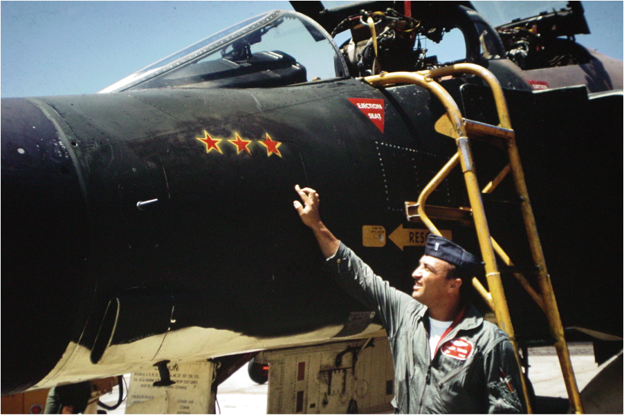 Capt. Milan Zimmer, Lt.Col Titus's WSO for his MiG kill on Route PAK 6, indicating the three stars for three MiGs shot down in 1967.
