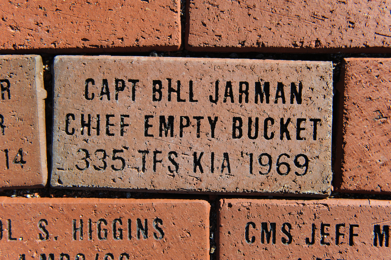 A brick dedicated to Capt. William Jarman Jr., an F-4 Phantom pilot with the 335th Tactical Fighter Squadron during the 1960s, who died in 1969 during an aircraft collision over Fort Bragg, N.C., lays in Heritage Park at Seymour Johnson Air Force Base, N.C., Nov. 14, 2014. Two bricks are inscribed with his name and service details. Bricks surround the Heritage Park F-15E Strike Eagle memorial fountain, commemorating heroes from the base's past. (U.S. Air Force photo/Airman 1st Class Aaron Jenne)