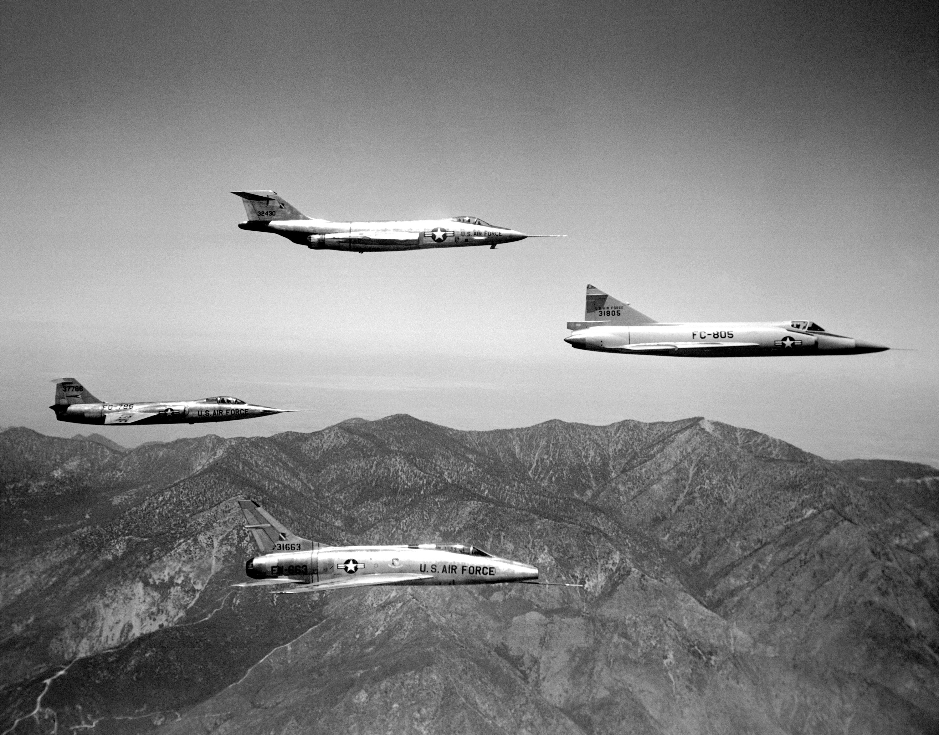 Four U.S. Air Force Century-series fighters in flight in 1957. These supersonic fighters were tested by the NACA Dryden Flight Research Center at Edwards Air Force Base, California (USA). The aircraft visible are: McDonnell F-101A-5-MC Voodoo (s/n 53-2430, top), Lockheed XF-104A Starfighter (53-7786, left). This aircraft crashed on 11 July 1957 due to an uncontrollable tail flutter. The pilot, Bill Park, ejected safely, Convair F-102A-20-CO Delta Dagger (53-1805, right), North American F-100A-20-NA Super Sabre (53-1663, bottom). ( Image by NACA Dryden Flight Research Center via wikipedia)