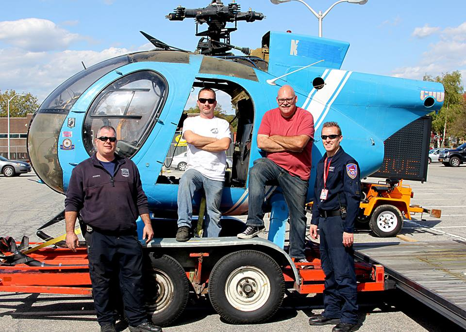 Rescuing a Hero - The Hughes OH-6A 67-16477 was operated by the Westchester County Police Aviation Unit for almost 20 years. - Westchester County Police Officer Brian Powers, CASC Volunteer Raymond Miller, Executive Director Andrew King and Westchester County Police Officer & Pilot Sean Lonergan