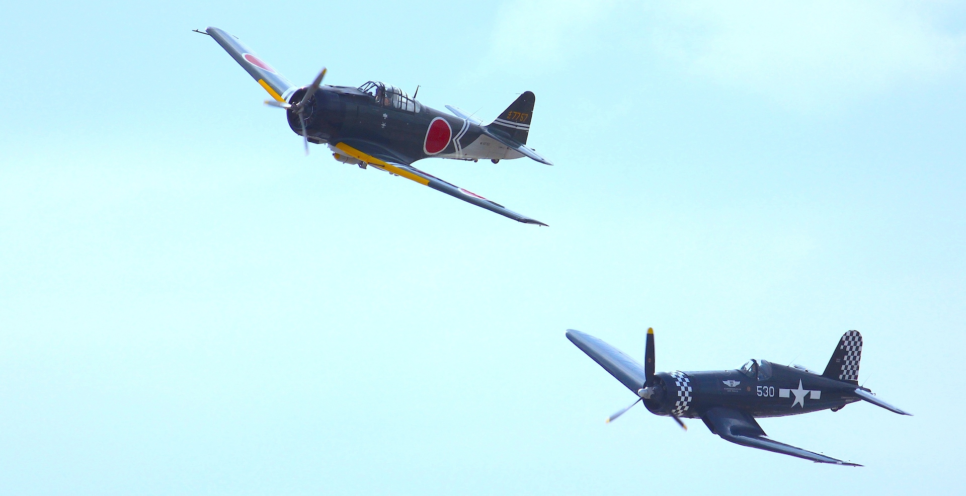 Jack Van Ness's ZERO replica chased by the CAF Dixie Wing's FG-1D Corsair during the 2014 Thunder in The Valley Airshow.