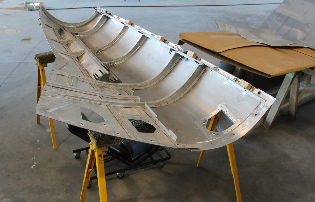 An interior view of the top right cowl for the right-hand engine during the tack-riveting process. Clecos are holding the ribs in place at this point. (photo via Tom Reilly)