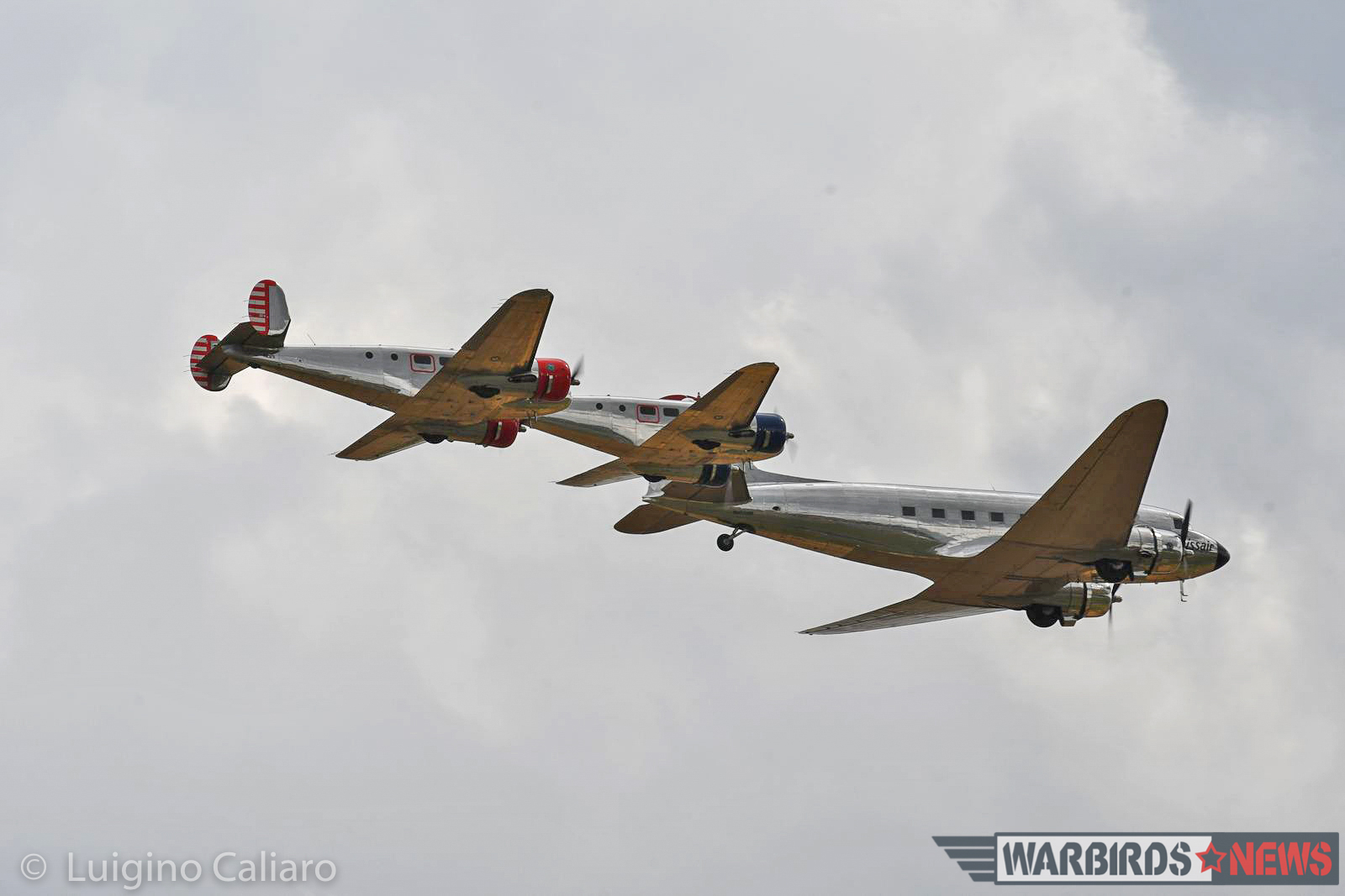 The Swissair DC-3 flies in tight formation with a pair of similarly-polished Beech Model 18s. (photo by Luigino Caliaro)